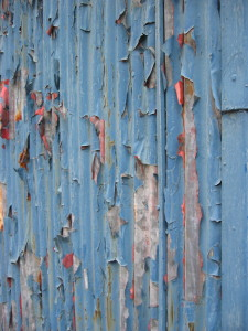 Blue peeling paint on a Tokyo building.