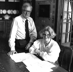 Architects and partners Robert Venturi and Denise Scott Brown sitting at a desk.