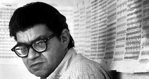 Morton Feldman with music scores in background